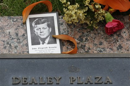 2013 JFK Anniversary memorial at Dealey Plaza A photo of President John F. Kennedy and flowers lie atop a plaque at Dealey Plaza in Dallas on Nov. 21.