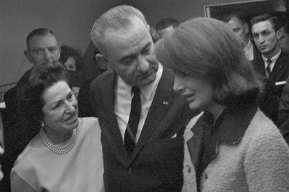 19631122d-17 President Lyndon B. Johnson, with his wife, Lady Bird, at left, and Jacqueline Kennedy moments after he was administered the oath of office on Air Force One, Nov. 22, 1963.
