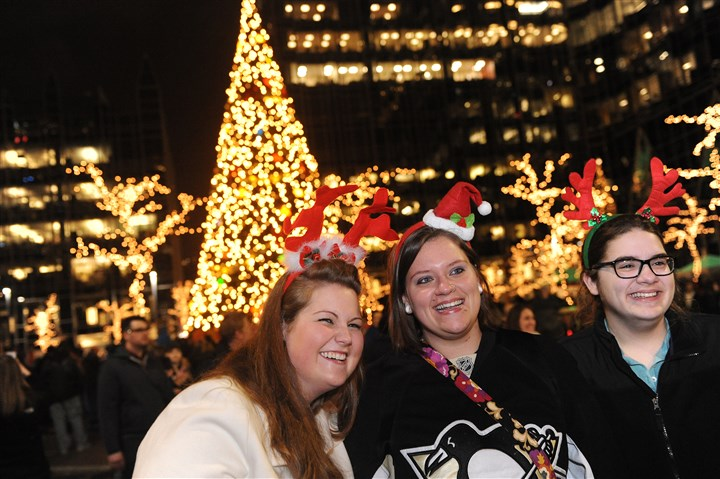 20131122rldLightUpLOCAL02-1 From left, Andrea Stynchula of Wilkins, Stehanie Wolfarth of Swissvale and Catherine Hickey of Wilkins enjoy Light Up Night Downtown on Friday.