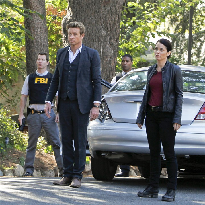"Mentalist Simon Baker as Patrick Jane, Robin Tunney as Teresa Lisbon in ""The Mentalist."""