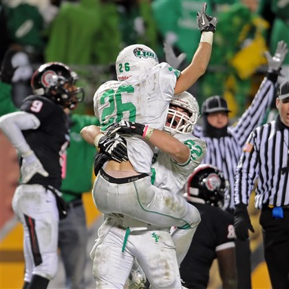 wpialnotes1124 South Fayette's Conner Beck is lifted by Spencer Girman after catching a touchdown pass from Brett Brumbaugh late in the second half of the WPIAL Class AA championship at Heinz Field Saturday night.