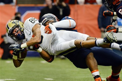 pitt1124a-29 Pitt's Kevin Weatherspoon is tackled by Syracuse's Lewellyn Coker on Saturday at the Carrier Dome in Syracuse, N.Y.