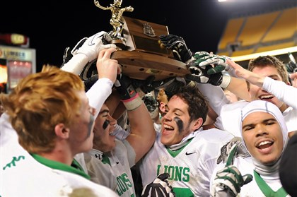 20131123mfheinzsports07-5 South Fayette teammates hold their trophy after defeating Aliquippa.