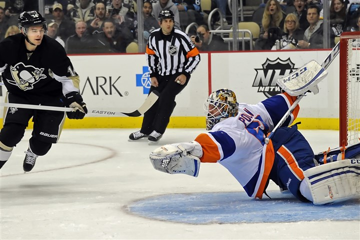 Penguin Chris Kunitz scores on Islanders  Chris Kunitz scores on Islanders goaltender Kevin Poulin in the first period at Consol Energy Center on Nov. 22.
