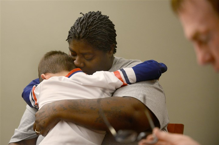 1123mhAdoptionDayLocal06-5 Eight-year-old Zackery hugs his new mom Kizzy Hazlip during the final remarks of Zackery's adoption hearing Saturday at Family Law Center, Downtown. A total of 41 adoptions were finalized as part of National Adoption Day. Kizzy and her wife, Sandy, adopted Zackery and three other children whom they had been fostering for two years.