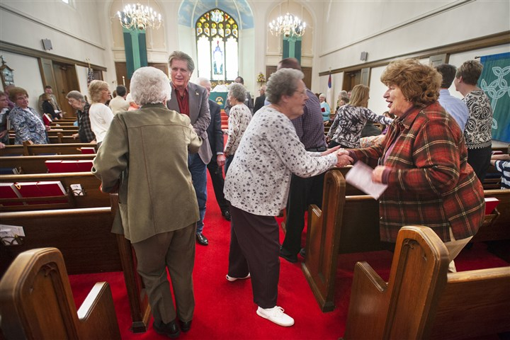 AP270479598229 Helen Stahley, left, Norma Meidwig, and Grace Russel greet each other at St. James Evangelical Lutheran Church Oct. 20, in West York, Pa.