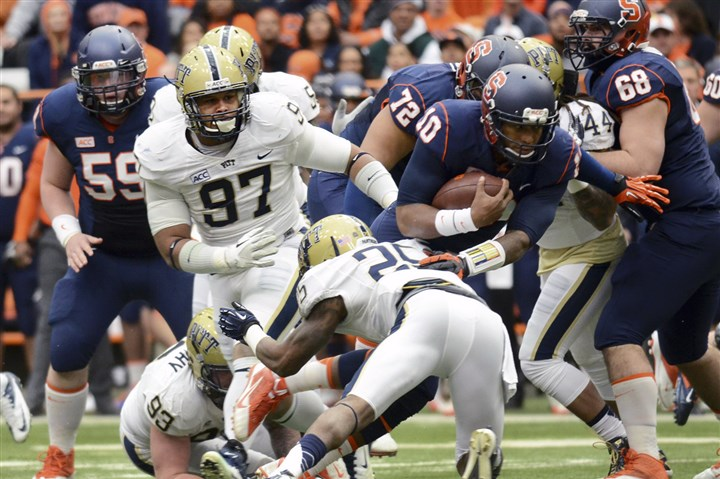 pittfb1125 Pitt's Aaron Donald (97) goes after Syracuse's Terrel Hunt during the team's 17-16 win against Syracuse in Syracuse, N.Y., Saturday.