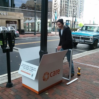 "Care1-1 Nine Care package displays were set up Monday at Atlantic Station in Atlanta. The displays emphasize the theme ""Deliver lasting change,"" part of a new branding campaign that Pittsburgh advertising agency Brunner created for Care."