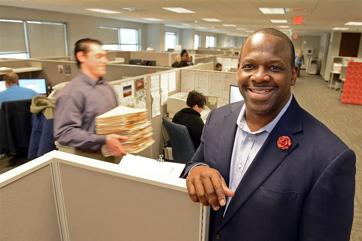 20131125radChuckSandersBiz01 Chuck Sanders in the offices of his Urban Lending Solutions in the Federated Investors Tower.