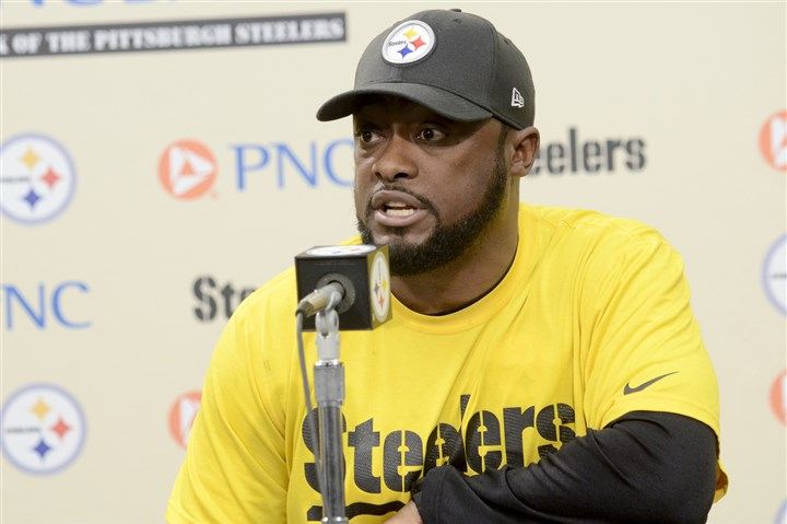 20131125arTomlin01 Steelers coach Mike Tomlin speaks during his weekly news conference at the team's South Side training facility on Monday.