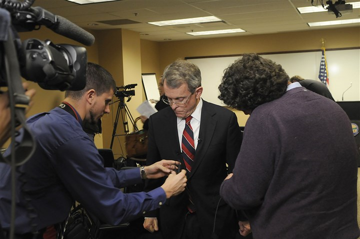 20131125lrdewinerapelocal03-3 Ohio Attorney General Mike DeWine prepares for an interview with CNN after announcing that a grand jury has indicted four people, including Steubenville's school superintendent, on charges relating to the rape of a 16-year-old girl in 2012.