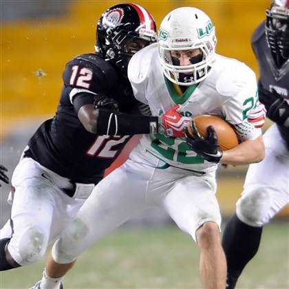 20131123mfheinzsports06.jpg South Fayette's Grant Fetchet is hit by Aliquippa's Terry Swanson in the first half of the WPIAL Class AA championship game at Heinz Field Saturday night.