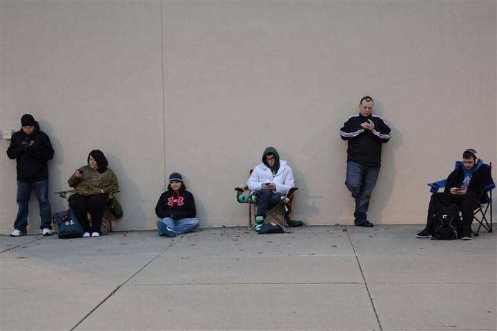 20131121ppResell2BIZ-1 Customers wait in line to purchase an Xbox One at the GameStop store on McKnight Road.