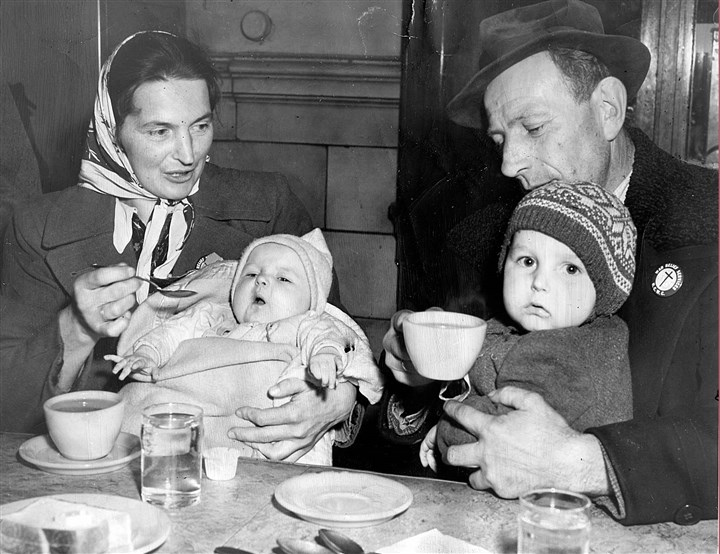 Thanksgiving care Among the thousands stranded in Pittsburgh by the 1950 storm was this family from Yugoslavia. From left are Frances Picynyk, holding 7-month-old Frances, and her husband Joseph, holding Joseph Jr., 2.