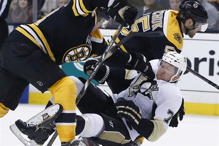 Penguins Bruins Hockey Bartkowski Penguins defenseman Paul Martin (7) is knocked down by Boston Bruins defensemen Matt Bartkowski, left, and Johnny Boychuk (55) in the third period in Boston on Nov. 25.