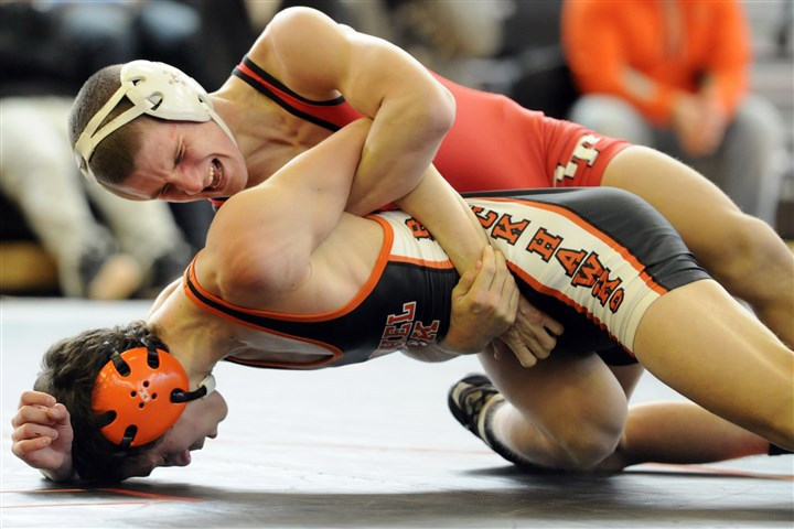 9bs00kiz.jpg Peters Township's Tyler Buckiso, top, looks for an advantage against Bethel Park's Michael Vogel in a 126-pound match last season.