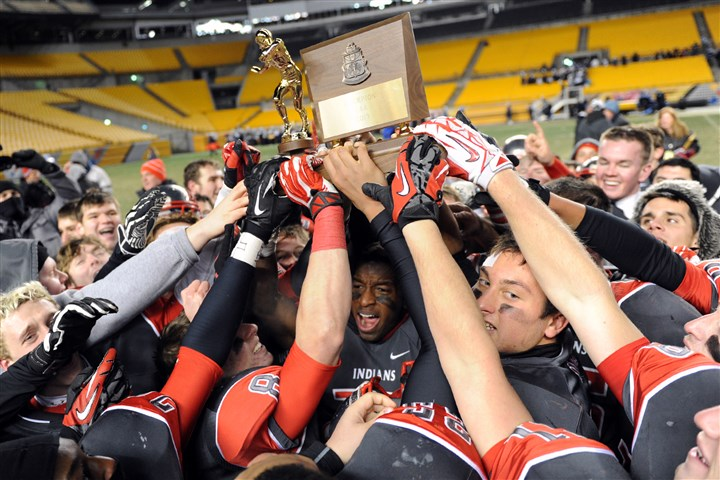 20131123mfheinzsports18.jpg West Allegheny teammates hoist their trophy after defeating Central Valley in the WPIAL Class AAA championship game at Heinz Field Saturday night.