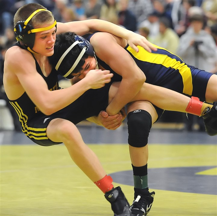 92800kov.jpg North Allegheny's Scott Stossel, battling Central Catholic's Vincenzo Joseph in the 106-pound weight class during the first round of the WPIAL team tournament at Kiski Area High School last season, rates as one of the top returning wrestlers in the North Xtra area.
