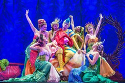 "Christian Probst as Flounder is surrounded by Ariel's sisters in the undersea world of ""Disney's The Little Mermaid,"" a Pittsburgh CLO production."