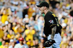 The Pirates' A.J. Burnett reacts after getting the Cardinals' Allen Craig to strike out to end the seventh inning of the first game of a double header at PNC Park in July 2013.