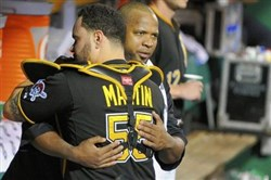 Russell Martin hugs Francisco Liriano in the Pirates dugout.