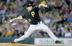 Pirates pitcher Mark Melancon celebrates after getting the final out against the Tigers at PNC Park Aug. 12.