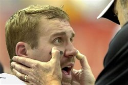 A Steelers physician checks Ben Roethlisberger in 2006 after he was knocked out of a game against Atlanta with a concussion. As per a new league policy change, there will be independent monitors on the sidelines to assure that head injuries and other neurological injuries are identified and treated promptly.
