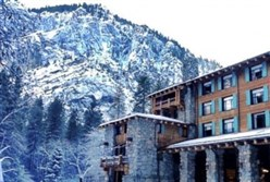 The Ahwahnee Hotel is set against the granite mountains of Yosemite National Park in winter.