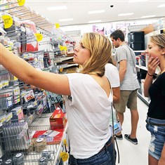 Shopping Tabitha Jermyn, left, reaches for some last-minute school supplies in an aisle at Target in East Liberty as Lauren Klingman looks on. Thursday night, freshmen from University of Pittsburgh were shuttled to the store for late-night shopping.