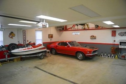 32- by 30-foot garage About 10 years ago, the current owner, a car enthusiast, added a 32- by 30-foot garage with room for up to four cars. The heated garage has an insulated garage door and a compressed air system to run power tools