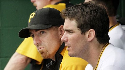 Adam LaRoche and Andy LaRoche Former Pirates first baseman Adam LaRoche, left, sits in the dugout with his brother, third baseman Andy LaRoche.