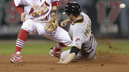 Alex Presley and Brendan Ryan Alex Presley, pinch-running for the Pirates, steals second as St. Louis shortstop Brendan Ryan cannot handle the throw from catcher Matt Pagnozzi in the seventh inning.
