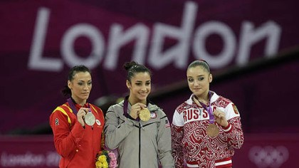 Alexandra Raisman U.S. gold medallist gymnast Alexandra Raisman, center, Romania's silver medallist Catalina Ponor, left, and bronze medallist Russia's Aliya Mustafina display their medals during the podium ceremony of the artistic gymnastics women's floor exercise final at the 2012 Summer Olympics, Tuesday Aug. 7, 2012, in London.