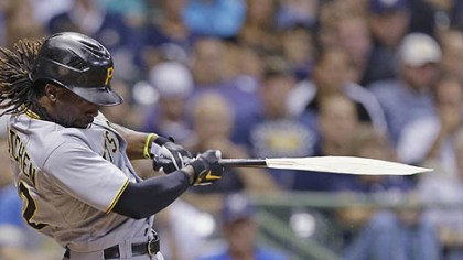 Andrew McCutchen Andrew McCutchen breaks his bat during his RBI single against the Milwaukee Brewers during the eighth inning.