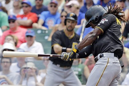Andrew McCutchen The Pirates' Andrew McCutchen hits a single against the Chicago Cubs during the first inning.