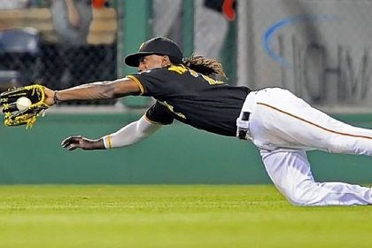 Andrew McCutchen Andrew McCutchen has been laying his body out more in the outfield this season and, in the process, come up with more balls than he has in previous season. He snares a drive hit by Miami's Adeiny Hechavarria Tuesday at PNC Park.