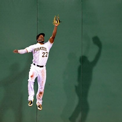 Andrew McCutchen The Pirates' Andrew McCutchen makes a leaping grab at the wall on a hit by Athletics left fielder Yoenis Cespedes at PNC Park.