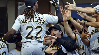 Andrew McCutchen Andrew McCutchen is greeted by his teammates at the dugout after he hit a two-run home run off Milwaukee Brewers' Marco Estrada during the third inning.