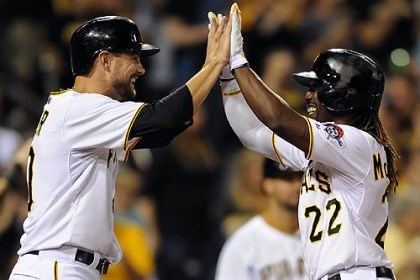 Andrew McCutchen and Jordy Mercer The Pirates' Andrew McCutchen is congratulated by Jordy Mercer after hitting a two-run home run against the Cardinals in the fifth inning of the second game of a double header at PNC Park Tuesday night.
