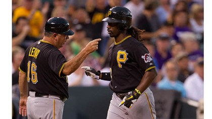 Andrew McCutchen and Nick Leyva Andrew McCutchen is congratulated by third base coach Nick Leyva after hitting a home run during the fourth inning against the Colorado Rockies.