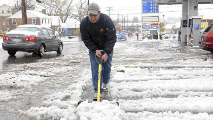 Angel Rodriguez Angel Rodriguez, 22, removes snow at a gas station parking lot in Morgantown, W.Va.