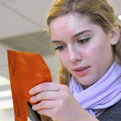Art 8 Student Emilia Riccinti fashions a flower petal from a copper sheet.