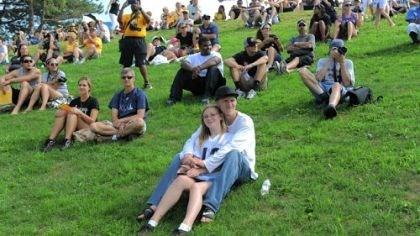 At practice Brandy Gruber and Jeremy Hilss of Freeport sit in front on the grassy hillside to watch the first public practice at Steelers training camp at Saint Vincent College in Unity on Friday.