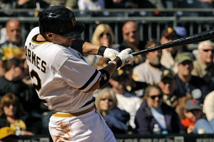 barmes The Pirates' Clint Barmes drives in Neil Walker for what would prove to be the winning run against the Braves in the sixth inning Sunday.