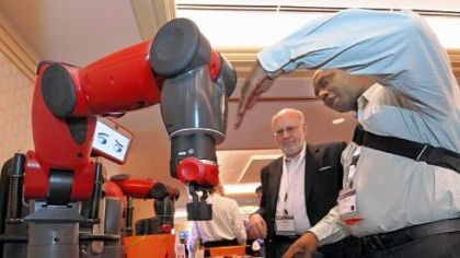 Baxter Baxter, an American-made robot manufactured by Rethink Robotics in Boston, is demonstrated to Anthony Jules, right, of Jules Studios by product manager Mike Bugda. The robot is fully equipped for about $25,000.