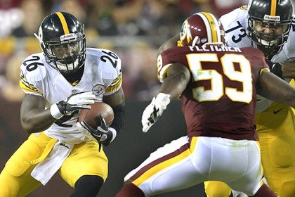 Bell Le'Veon Bell picks up yardage against the Redskins in the first half Monday.