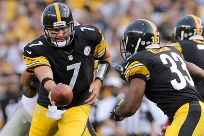 Ben Roethlisberger Steelers quarterback Ben Roethlisberger hands off to Isaac Redman against the Giants in the first quarter.