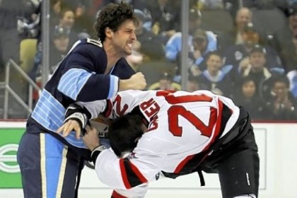 BortuzzoFight The Penguins' Robert Bortuzzo, left, fights the Devils' Ryan Carter on the opening faceoff.