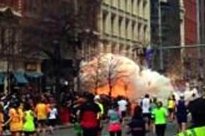 Boston Marathon explosion In this image from video provided by WBZ TV, spectators and runners run from what was described as twin explosions that shook the finish line of the Boston Marathon.