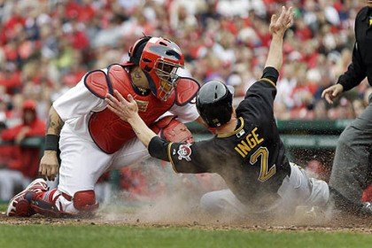 Brandon Inge The Pirates' Brandon Inge scores ahead of the tag from St. Louis Cardinals catcher Yadier Molina in the sixth inning.